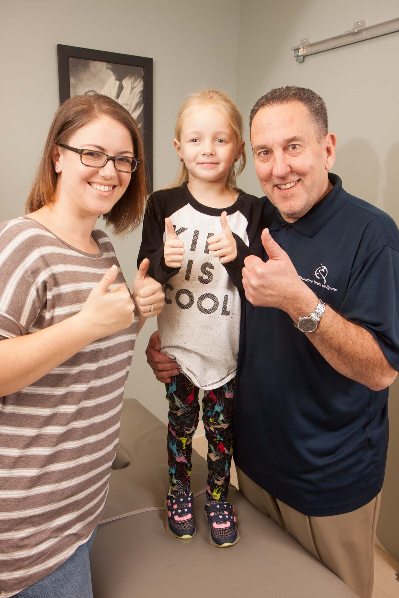 Dr. Bubanic with patients giving thumbs up